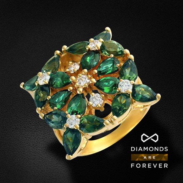 Кольцо с изумрудом, бриллиантами из желтого золота 750 пробы Perfect FlowerКольца<br>Кольцо из желтого золота 750 пробы, украшенное 7 бриллиантами общим весом 0.72 карат и 18 изумрудами общим весом 5.79 карат<br>