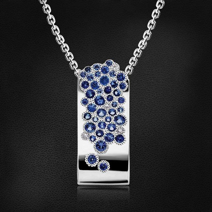 Подвеска с сапфиром, бриллиантами из белого золота 585 пробыКулоны<br>Подвеска с сапфиром, бриллиантами из белого золота 585 пробы. Характеристики вставок: 4бриллиант круг 0,030ct3/5, 4сапфир синий круг 0,130ct2/2, 3сапфир синий круг 0,060ct2/2, 6сапфир синий круг 0,097ct2/2, 9сапфир синий круг 0,109ct2/2, 6сапфи...<br>