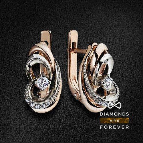 Серьги с бриллиантами из комбинированного золота 585 пробыЮвелирные украшения<br>Серьги с бриллиантами из комбинированного золота 585 пробы. Характеристики вставок: 12 бриллиантов 0.21 карат. Средний вес: 5,92 гр.<br>