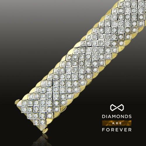 Браслет с бриллиантами из комбинированного золота 750 пробыБраслеты<br>Браслет с бриллиантами из комбинированного золота 750 пробы. Характеристики вставок: бриллиант 2/7 63шт.,1.58ct ; бриллиант 3/4 4шт.,0.01ct ; бриллиант 3/6 144шт.,3.66ct ; бриллиант 3/7 115шт.,2.96ct. Средний вес изделия: 84,19 гр.<br>