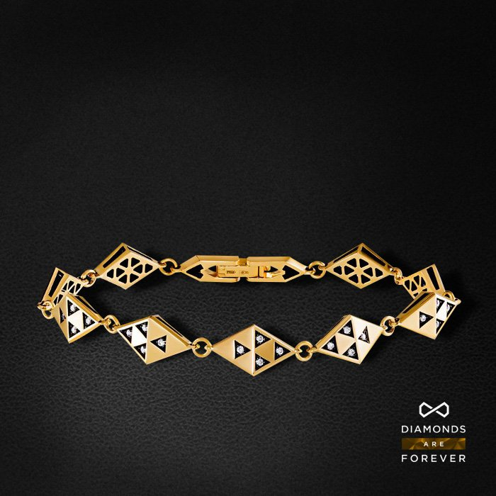 Браслет с бриллиантами из желтого золота 585 пробыБраслеты<br>Браслет с бриллиантами из желтого золота 585 пробы. Характеристики вставок: 36 бриллиант 0,305. Средний вес изделия: 12.31 гр.<br>