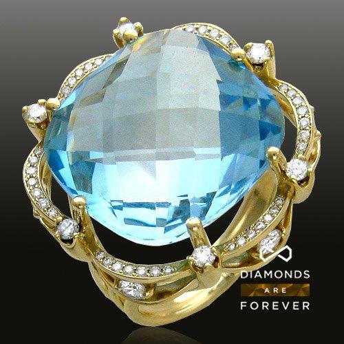 Кольцо с топазом, бриллиантами из желтого золота 750 пробыЮвелирные украшения<br>Кольцо с топазом, бриллиантами из желтого золота 750 пробы. Характеристики вставок: бриллиант 2/5 30шт.,0.11ct ; бриллиант 3/3 6шт.,0.16ct ; бриллиант 3/3 6шт.,0.4ct ; бриллиант 3/4 12шт.,0.03ct ; топаз  1шт.,24.04ct. Средний вес изделия: 12,63 гр.<br>