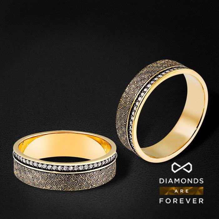 Мужское кольцо с бриллиантами в желтом золоте 585 пробыДля мужчин<br>Мужское кольцо с бриллиантами в желтом золоте 585 пробы. Характеристики вставок: 61 бриллиант 0.271. Средний вес: 5,78 гр.<br>