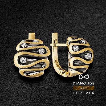 Серьги из комбинированного золота 585 пробы с 6 бриллиантамиЮвелирные украшения<br>Серьги золотые с 6 бриллиантами. Характеристики вставок: 6 брил. весом 0.077 ct. Средний вес: 9.33 гр.<br>