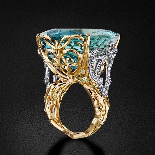 Кольцо с бриллиантами, аквамарином из комбинированного золота 750 пробыКольца<br>Кольцо с бриллиантами, аквамарином из комбинированного золота 750 пробы. Характеристики вставок: 4 бриллиант кр57 - 0,04 3/5а, 6 бриллиант кр57 - 0,045 3/4а, 60 бриллиант кр57 - 0,166 3/4а, 21 бриллиант кр57 - 0,097 3/5а, 31 бриллиант кр57 - 0,064 3/4а, 1...<br>