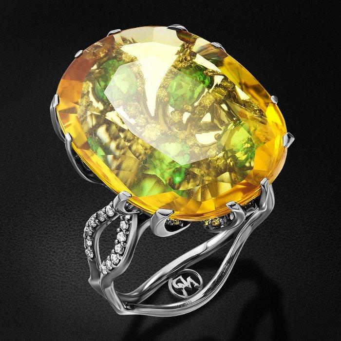 Кольцо с цветными сапфирами, бриллиантами, тсаворитом из белого золота 750 пробыКольца<br>Кольцо с цветными сапфирами, бриллиантами, тсаворитом из белого золота 750 пробы. Характеристики вставок: 4 бриллиант (n) кр57 - 0,08 3/5а, 76 бриллиант (n) кр57 - 0,36 3/4а, 2 бриллиант (n) кр57 - 0,02 3/6а, 7 тсаворит - 1,22, 1 сапфир - 17,53 цвет.. Сре...<br>