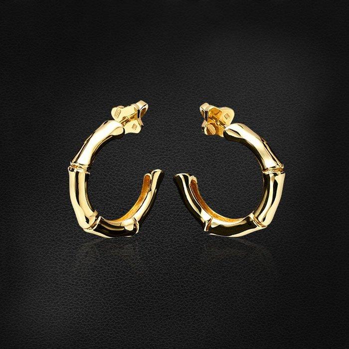 Серьги Бамбук в виде небольших полуколец из желтого золота 585 пробыСерьги<br>Серьги Бамбук в виде небольших полуколец из желтого золота 585 пробы. Средний вес изделия: 5,57 гр.<br>
