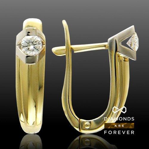 Серьги с бриллиантами из комбинированного золота 750 пробыСерьги<br>Серьги с бриллиантами из комбинированного золота 750 пробы. Характеристики: бриллиант 3/5 2шт.,0.26ct. Средний вес изделия: 5,71 гр.<br>