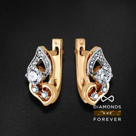 Серьги с бриллиантами из красного золота 585 пробыСерьги с бриллиантами<br>Серьги с бриллиантами из красного золота 585 пробы. Характеристики вставок: 2 бриллиант кр57 0,50; 24 бриллиант кр57 0,167. Средний вес изделия: 4.26 гр.<br>