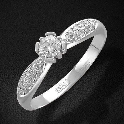 Кольцо с бриллиантами из белого золота 585 пробыЮвелирные украшения<br>Кольцо с бриллиантами из белого золота 585 пробы. Характеристики вставок: бриллиант 2/6 20шт.,0.14ct ; бриллиант 5/3 1шт.,0.21ct. Средний вес изделия: 2,01 гр.<br>