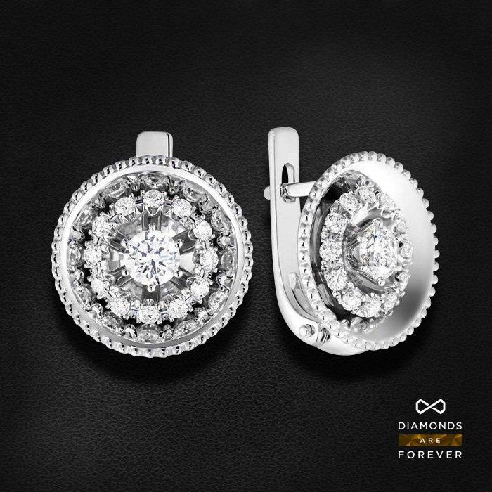 Серьги с бриллиантами из белого золота 585 пробыСерьги<br>Серьги с бриллиантами из белого золота 585 пробы. Характеристики вставок: 26 бриллиант 0,795. Средний вес изделия: 6.5 гр.<br>