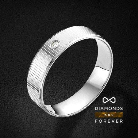 Обручальное кольцо с бриллиантами из белого золота 585 пробыКольца<br>Обручальное кольцо с бриллиантами из белого золота 585 пробы. Характеристики вставок: бриллиант 1 0.014 3/5 круг. Средний вес изделия: 3,21 гр.<br>