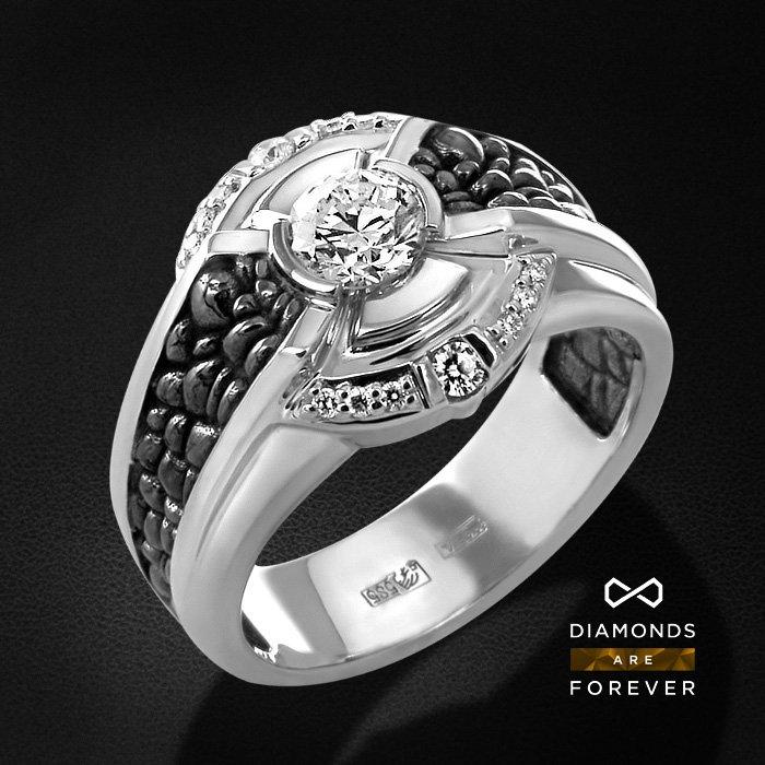 Мужское кольцо с бриллиантами из белого золота 585 пробыПерстни<br>Мужское кольцо с бриллиантами из белого золота 585 пробы. Характеристики вставок: 1 бриллиант кр57 0.63; 14 бриллиант кр57 0.143. Средний вес изделия: 4.14 гр.<br>