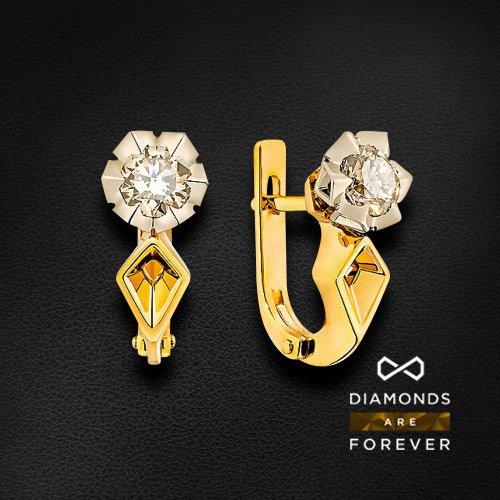 Серьги с бриллиантами в комбинированном золоте 585 пробыСерьги<br>Серьги с бриллиантами в комбинированном золоте 585 пробы. Характеристики вставок: 2 бриллиант 1.065. Средний вес: 5,68 гр.<br>