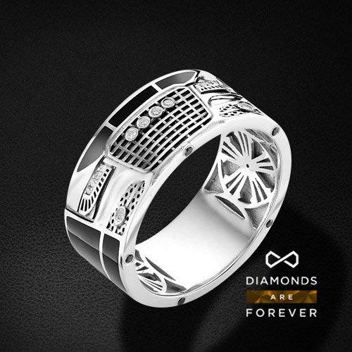 Мужское кольцо Audi с бриллиантами из белого золота 585 пробыПерстни<br>Мужское кольцо audi с бриллиантами из белого золота 585 пробы. Характеристики вставок: бриллиант 14 0.058 3/6 кр57, бриллиант черный 10 0.065 кр57. Средний вес изделия: 10.46 гр.<br>